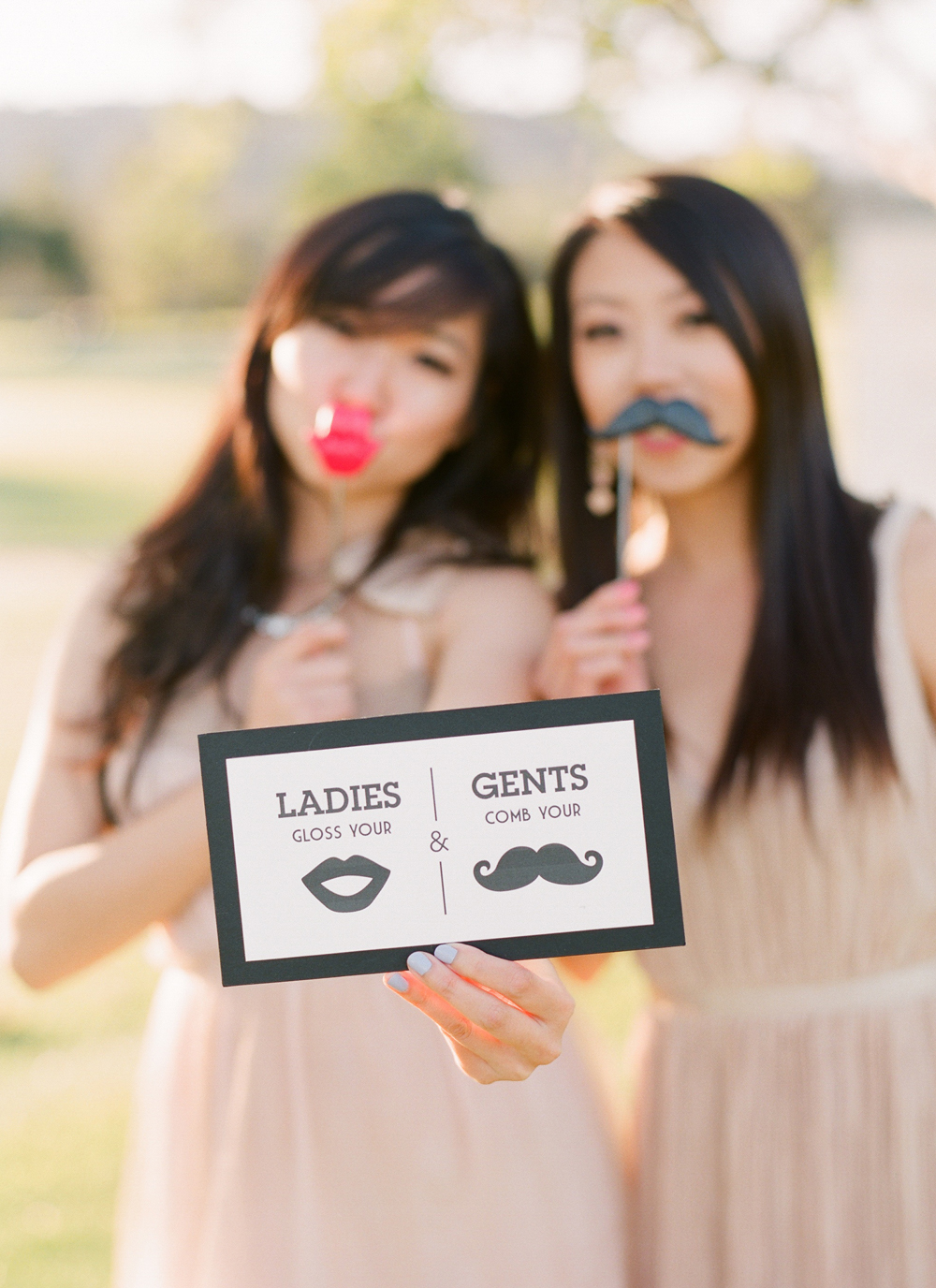 Event Guests Pose with Lips and Moustache
