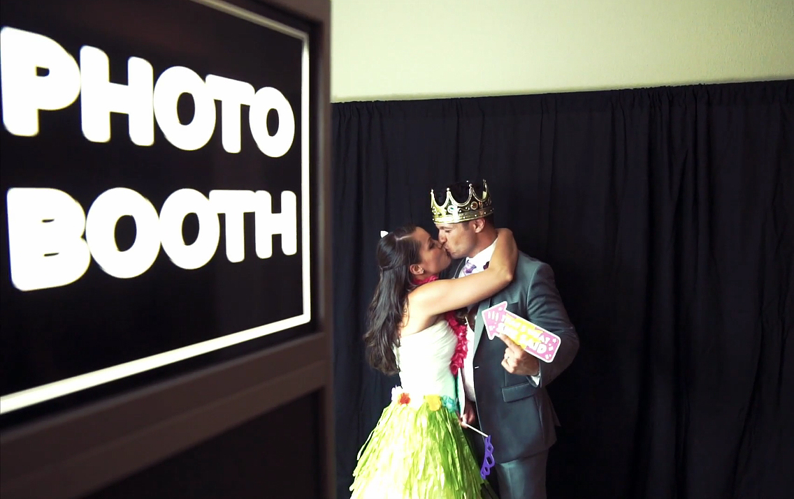 The Newlyweds Share a Kiss in the Photo Booth
