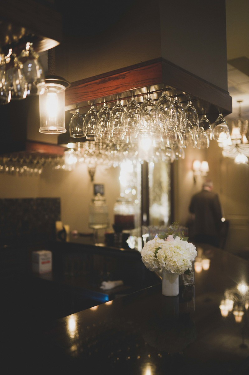 White Flowers Decorate a Swanky Bar Area