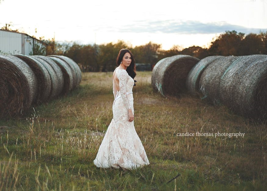 Lindsey Stands Between Hay Barrels for a Rustic Look