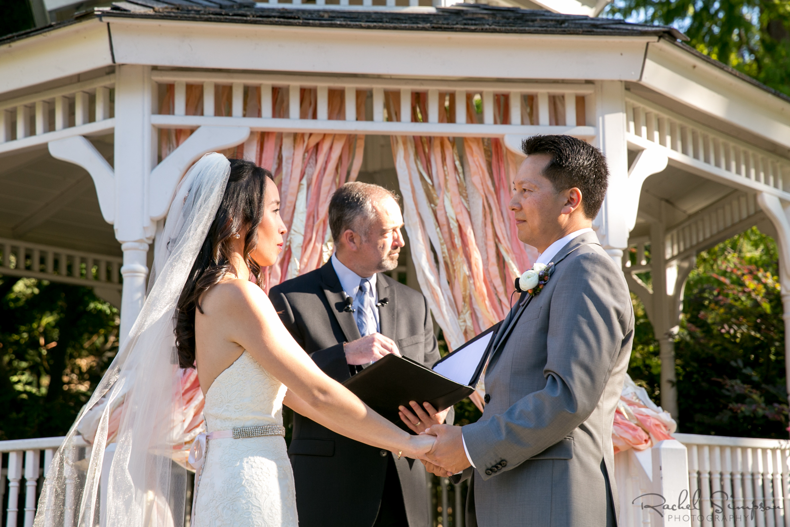 Bride and Groom Exchange Vows with Gazebo Backdrop